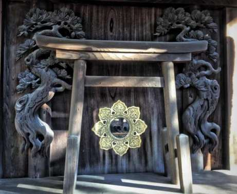Torii Gate with mirror on small shrine at Sumiyoshi Taisha Shinto Shrine