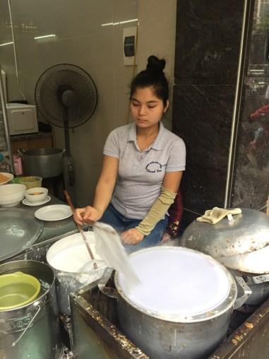 Woman making Banh Cuon at Thanh Van Banh Cuon