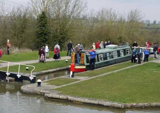 Canal boat navigating locks.
