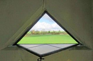 Looking through a triangular window.