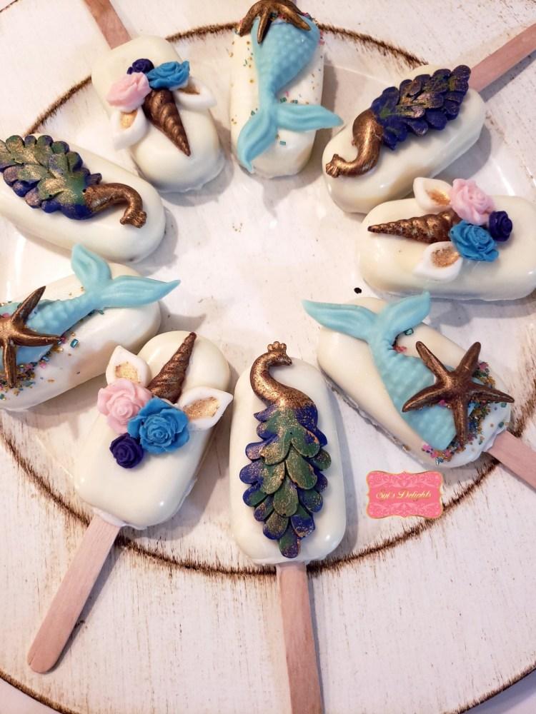 Peacock cakesicles