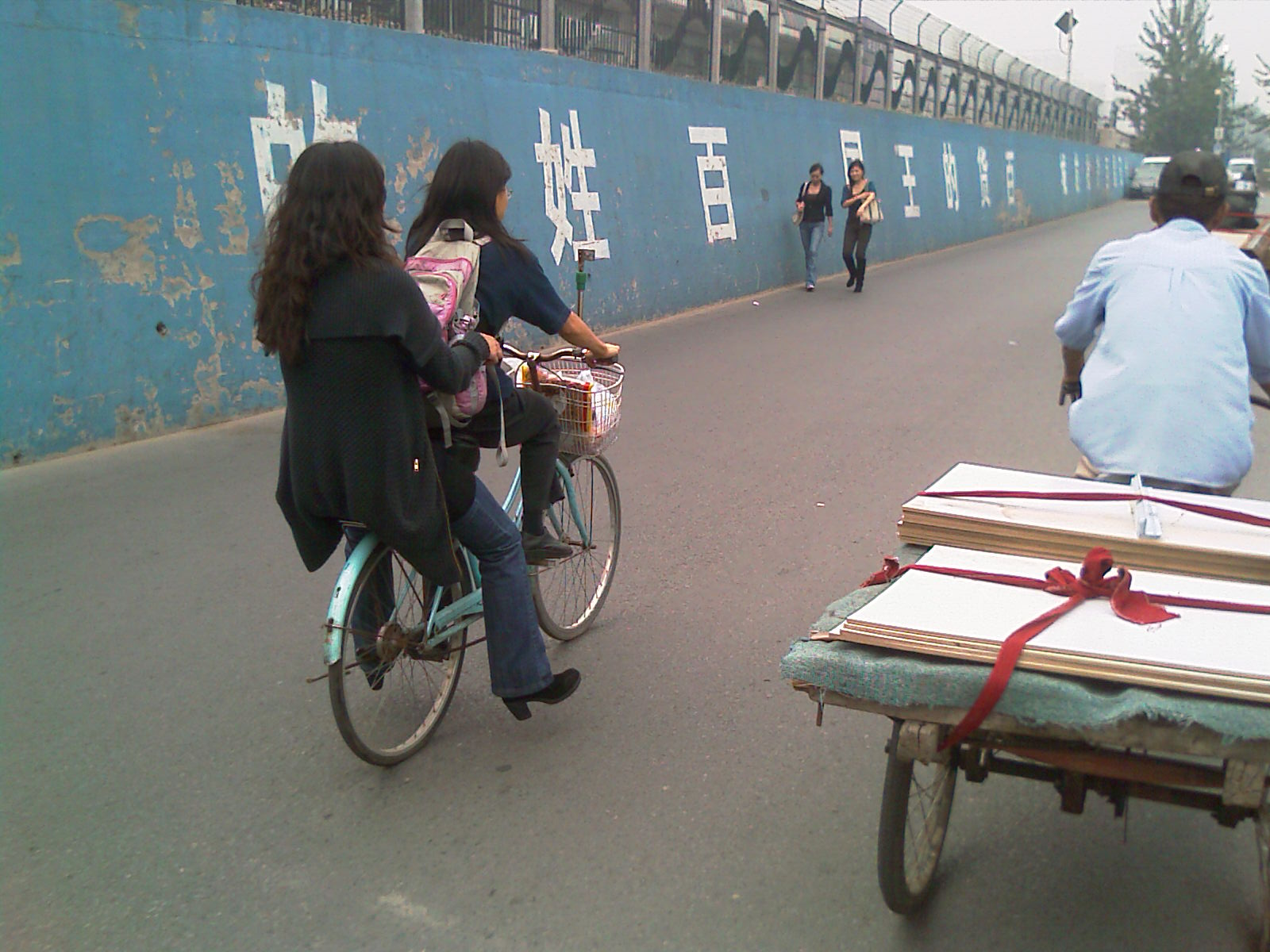 Hitching a ride from my friend Wingee. We shopped at a fruit wholesaler - this is the real China experience, boys and girls.