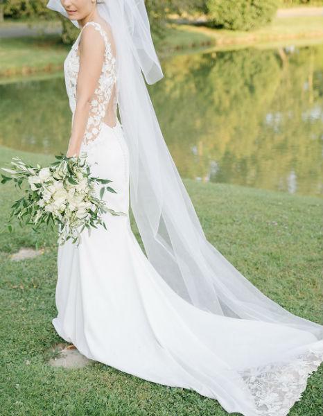 robe de mariée sur mesure et sa traîne