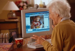 ca. 2000 --- Video Conferencing with Granddaughter --- Image by © Jose Luis Pelaez, Inc./CORBIS