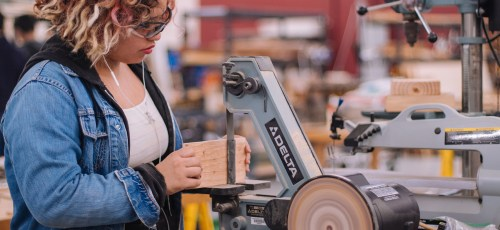 woman working at woodshop