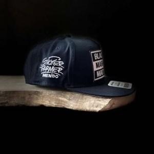 SYMBYS and Sticker Farmer Black Markets Matter Trucker Hat