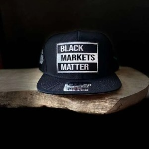 SYMBYS and Sticker Farmer Black Markets Matter Trucker Hat