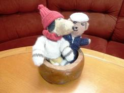 """Pet Officer Snoopy and Jolly Wodger making friends in the dog bowl carved from the timbers of the historic Falklands wreck of the """"Vicar of Bray"""""""