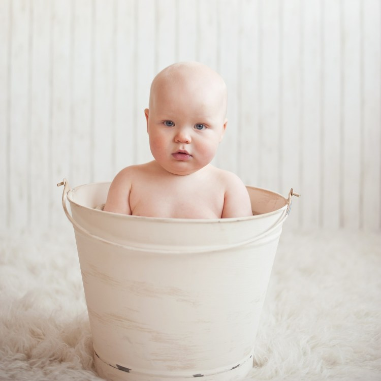 Baby in metal bath tub