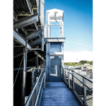 Vertical platform lift for stadium seating access at school