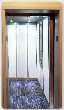 Custom LULA Elevator Car with Laminate Applied Panel in Designer White