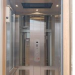 Symmetry Residential Elevator glass and stainless steel installed by Morning Star