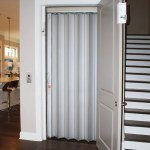 Symmetry Residential Elevator with Aluminum Accordion Door installed by American Elevator