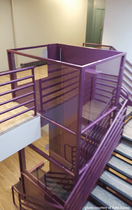 Symmetry Vertical Platform Lift in purple installed by Area Access