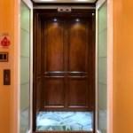 Symmetry Residential Elevator Dark Car Panels Custom Flooring