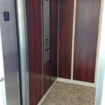Symmetry LU/LA Elevator with applied panels carpeted floor