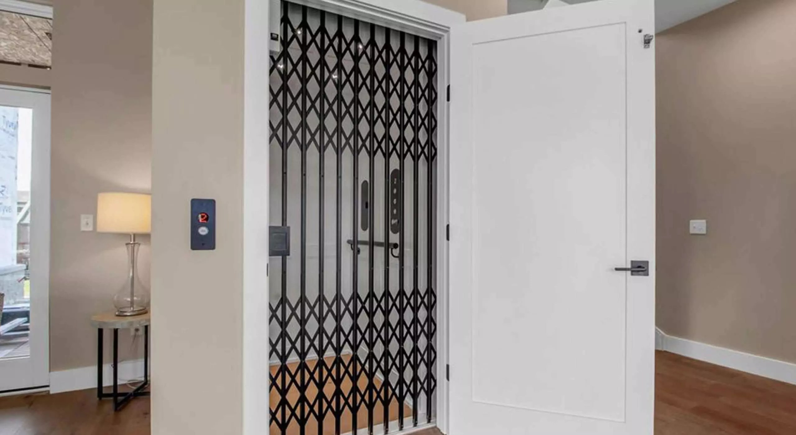 Symmetry Home Elevator in White with Black collapsible gate-blog