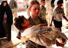 Soldier with wounded Iraqi child (PDI)