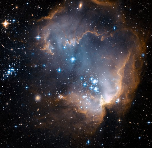 New stars forming in N90, a  stellar nursery in the constellation Hydrus, 200,000 light years away. Credit: NASA, ESA and the Hubble Heritage Team STScI/AURA)-ESA/Hubble Collaboration