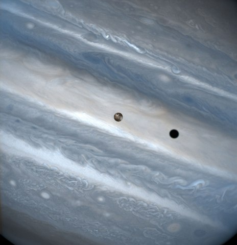 Io, one of Jupiter's moons, in transit around the giant planet. Io travels quickly, completing an orbit of Jupiter every 1.8 days. Credit: J. Spencer (Lowell Observatory) and NASA/ESA