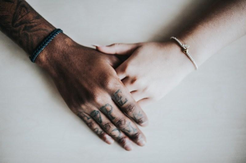 adult_bracelets_couple_fashion_girl_hands_holding_hands_indoors-1364623-1