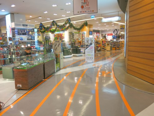 One walkway inside Siam Paragon, designed like racing road as this floor sells sports products