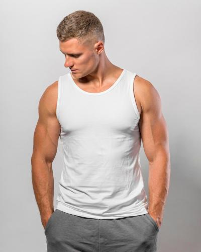 handsome-fit-man-posing-while-wearing-tank-top