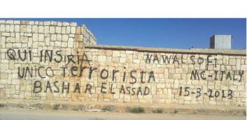 """Italian national illegally entered Syria, sprawling graffiti on a Syrian wall: """"Here in Syria the only terrorist is Bashar Assad."""""""
