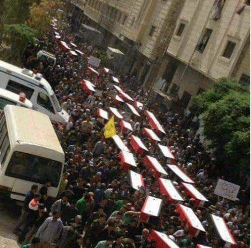 mass funeral service for the massacred of al Rashidin