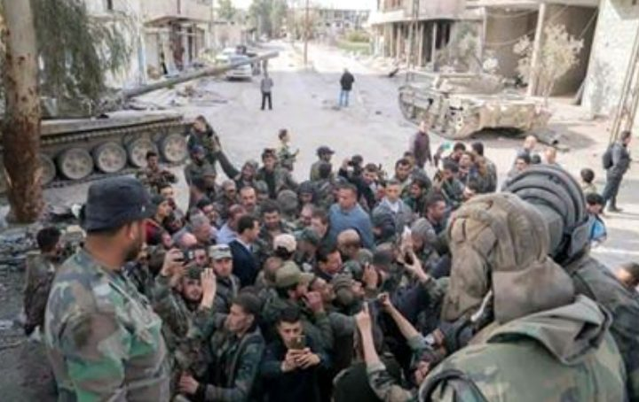 image-President Assad, surrounded by members of the courageous Syrian Arab Army.