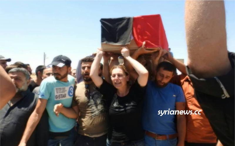 Mother of Syrian Journalist Martyr Khalid Al Khatib carrying his coffin