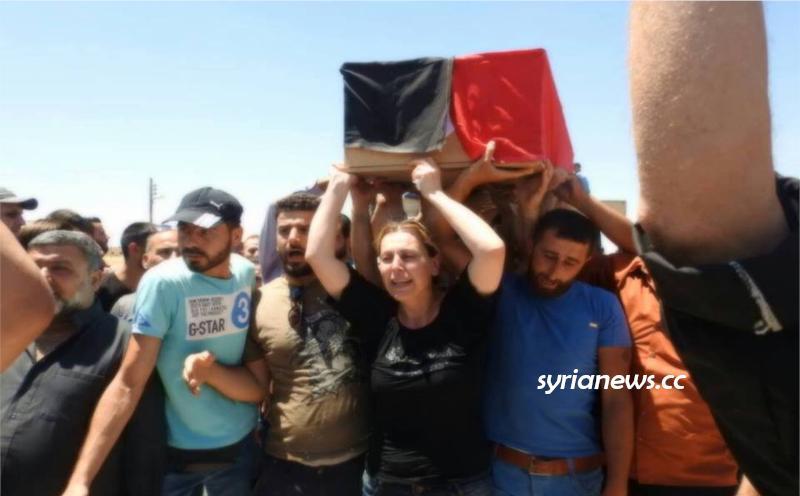 Mother of Syrian Journalist Martyr Khalid Al Khatib carrying his coffin
