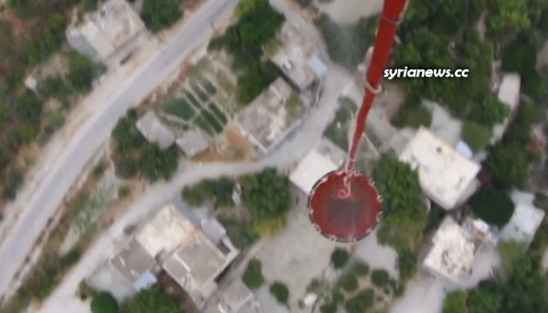 Russian Military Helicopters Help Extinguish a Fire in Jableh Countryside