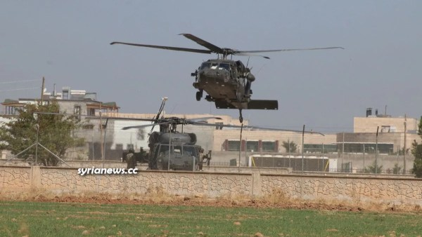 US sponsored kurdish sdf terrorists with US army helicopters in northern Syria