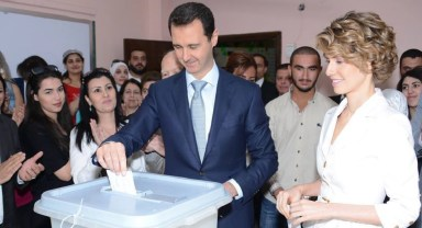 bashar-al-assad-vota-20140603-damasco
