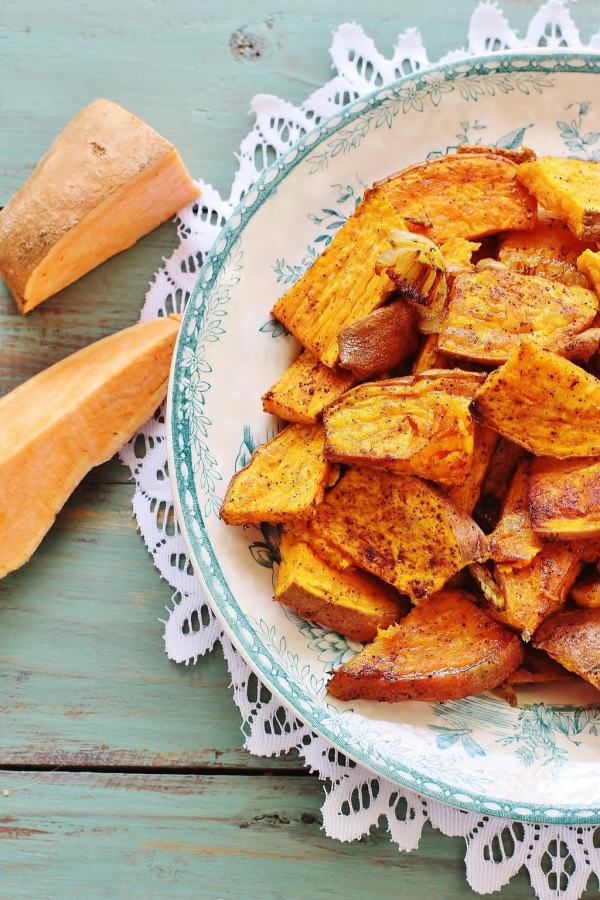 Chili Roasted Sweet Potatoes. A savory dish of sweet potatoes, sweet onions, chili powder, salt, pepper and garlic powder. You're missing out if you've never tried sweet potatoes as a savory.