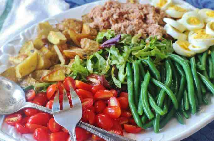 Tuna Nicoise Salad. A hearty salad made with tuna, roasted potatoes, green beans, boiled eggs and fresh tomatoes.