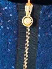 En glidelås er ikke bare en glidelås - Tine har disse flotte glidelåsene som nærmest er et lite smykke