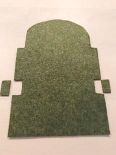 Etuiet er klippet ut i grønn filt
