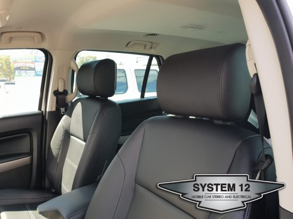 Front view of Schenider DVD headrests fitted to 2018 Ford Everest
