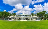 .Palatial Property Set on six private acres on the Atlantic Ocean in one of the most expensive neighborhoods in the United States, Dion's Bahamian-style 10,000-square-foot home boasts eight bedrooms and a covetable 415 feet of private beach.