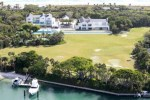 Tiger Woods house in Jupiter Florida makes most large homes look like a shack. He purchased the property for an estimated 40 million dollars. The home it self is 9,000 square feet but its the back yard that really sets it apart. Tiger has 4 150 yard golf holes where he can practice. He also has a full running track back there as well.