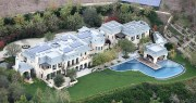 This beauty was built by Tom Brady and Gisele Bundchen for just a mere 22 million dollars. The house is located in a swanky area of Los Angles. According to Huff Post it is 22,000 square feet and has 8 bedrooms, 6 car garage, pool, spa, weight room and wine cellar. Dr. Dre bought the home after selling his interest in Beats to Apple