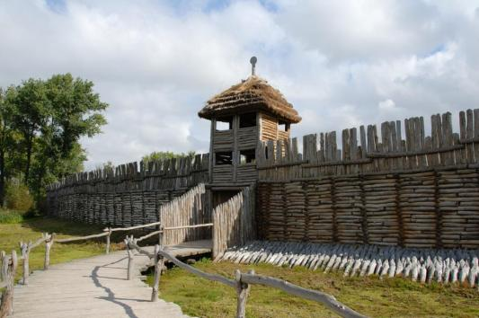 Bronze gate and wall in Biskupin - reconstructed Lusatian culture settlement from Bronze Age