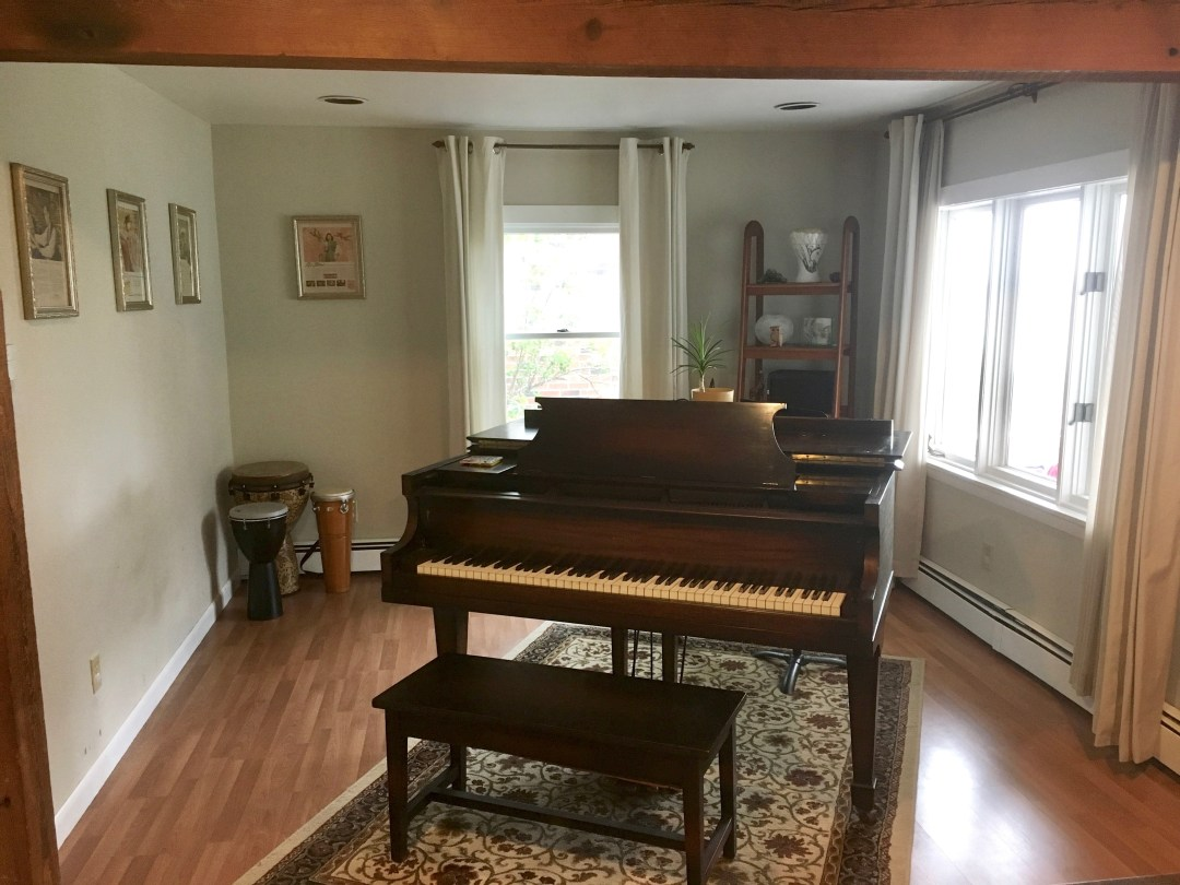 piano room (open to kitchen/dining area)