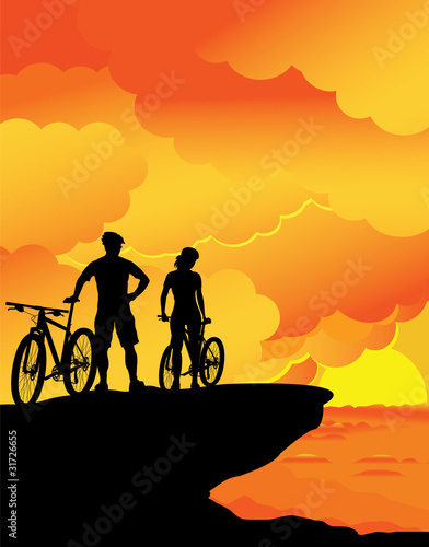 A boy and a girl – sunset landscape.