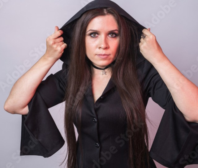 Gorgeous Brunette With Dark Makeup Halloween Witch With Smoke In Studio