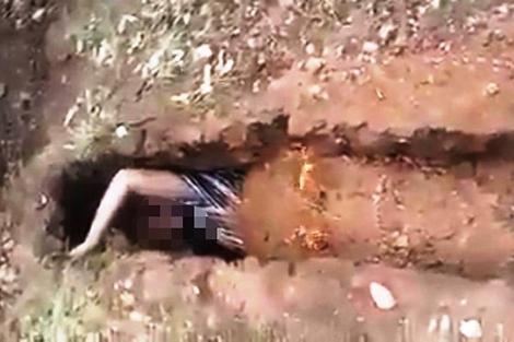 الأمن يكشف حقيقة فيديو دفن ملتح لنفسه في قبر