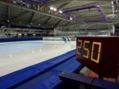 Mallory skates a marathon on ice. Photo taken 250 laps in. A full marathon is 379 laps.