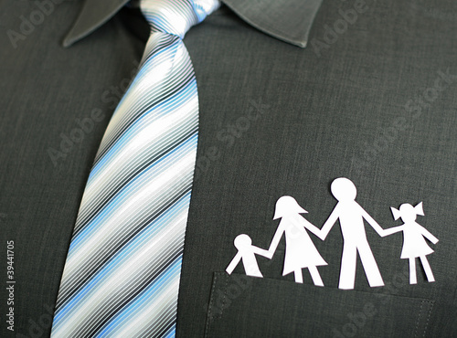 Paper family in a pocket stock image